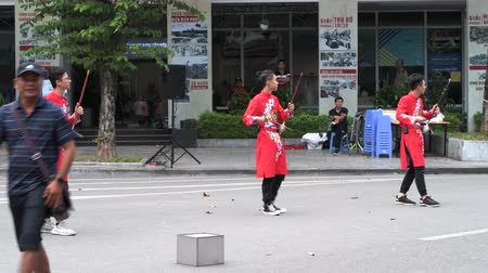 north vietnam : Hanoi, Vietnam - 11th October 2019: Live performers play music in the street as its closed to traffic on Weekends