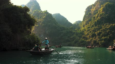 Ha Long, Vietnam - 15th October 2019: Tour guides take tourists around Ha Long Bay on boat through limestone caves
