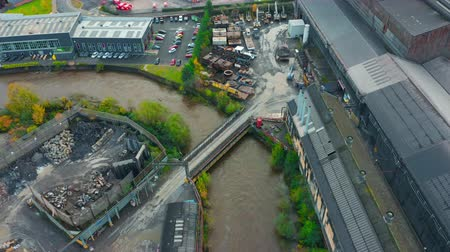 eight : Sheffield, UK - 8th November 2019: Aerial view - The River Don floods after flash floods flooding local offices and buildings in Yorkshire.