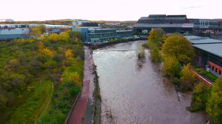 kurutma : Sheffield, UK - 8th November 2019: Aerial view - The River Don floods after flash floods flooding local offices and buildings in Yorkshire.
