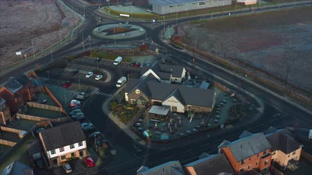 Rotherham, UK - 30th November 2019: Aerial footage of The Winter Green, a Marstons pub in Waverley, Rotherham, UK. Shot from above in Winter