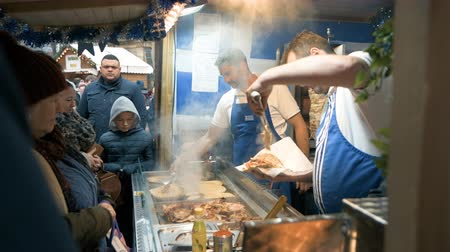 Sheffield, UK - 30th November 2019: Customers queue up for tasty looking Greek Gyros served at Sheffield Christmas Market stalls Stock Footage