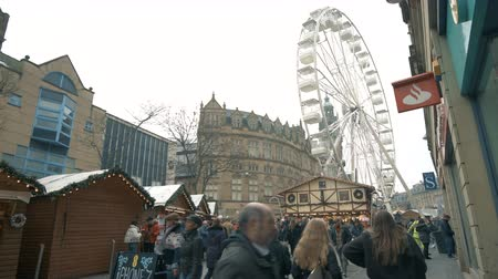 Sheffield, UK - 30th November 2019: Customers flock to Sheffield Christmas market to taste holiday food and drink and ride the large ferris wheel