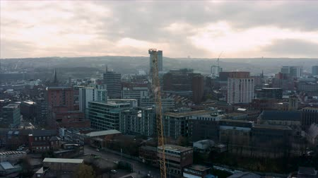 Sheffield, UK - 1st December 2019: Aerial view of a crane and construction sites around Sheffield City, South Yorkshire, during a beautiful cold sunrise