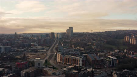 Sheffield, UK - 1st December 2019: Aerial fly over Sheffield City, South Yorkshire, UK during a beautiful golden winter sunrise