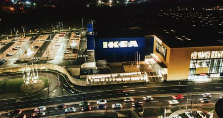 Sheffield, UK - 16th December 2019: 4K Aerial night time lapse of the front of Ikea in the middle of the city of Sheffield as traffic builds up outside during rush hour Stock Footage