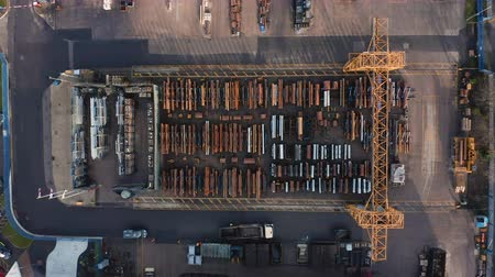 nakládané : Sheffield, UK - 16th December 2019: Aerial view of steel pipes in outside storage being collected with a forklift truck in Winter