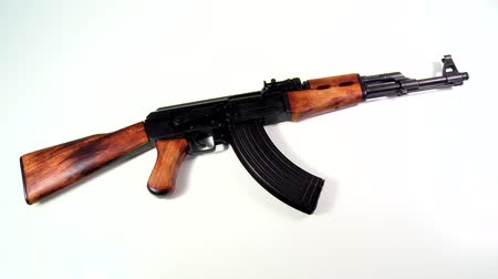 munitions : AK 47 Kalashnikov 1947, beauty-shot on white background, long-shot-still with a light zoom in.