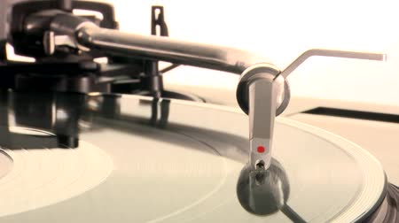 tonearm : DJ Turntable. Dropping the needle on a spinning vinyl record player and take it back. Close-up beauty-shot on white background. Stock Footage