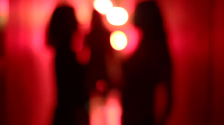 танцоры : Silhouette of two sexy women dancing in a blurry, red corridor with her hands raised. Стоковые видеозаписи
