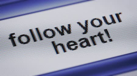 seu : follow your heart! on a screen. Looping. Vídeos