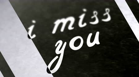 memo : i miss you in the page. Negative image. Looping footage has 4K resolution. Stock Footage