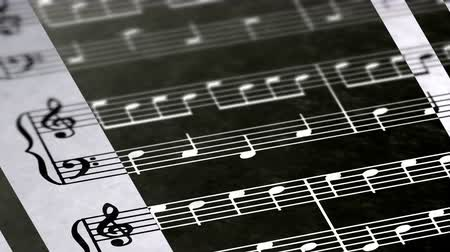 texto : Music notes in the page. Negative image. Looping footage has 4K resolution.