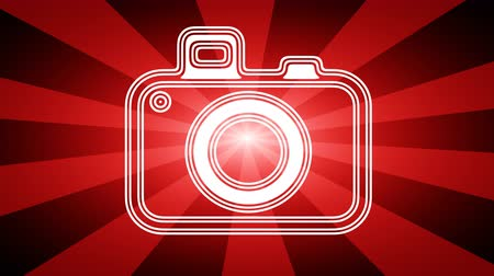 film camera : Camera icon in red abstract background with rays. Looping footage with Prores 4444 and 4K resolution.