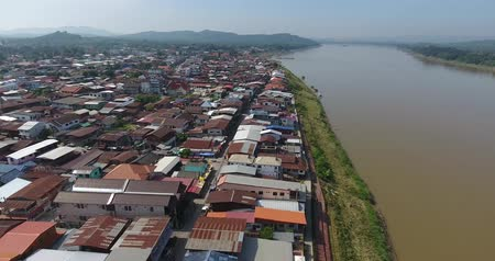 chiangkhan : 4K Aerial View. Flying over The Mekong River.Chiang Khan District. Aerial camera shot. Chiangkhan , Loei, Thailand.