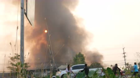koruma : Lamphun, Thailand - April 9, 2016:Fire recycling warehouse, causing a large flame and smoke in the air is very hot days. Firemen rush to help prevent the spread of fire , In Thailand.