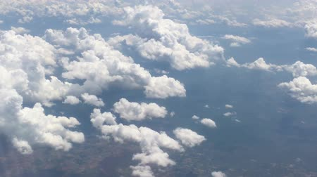 cloud scape : view from aircraft window with blue sky and clouds