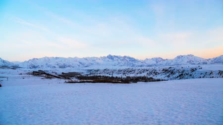Mountains of the western Tien Shan in the snow at sunset in the early spring. TimeLapse 4K.