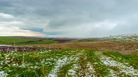 4K, TimeLaps. Snow fell on the spring agricultural fields, in the Aqsa Dzhabaglinsky Reserve, the Western Tian Shat