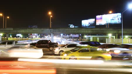 crossway : Highway driving busy traffic at night, time lapse pan shot