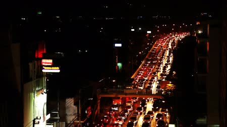 crossway : Traffic jam in city, busy traffic at night Stock Footage