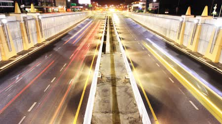 night : Highway traffic driving time lapse tilt up