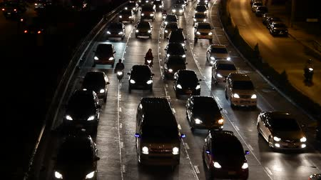 night : highway busy traffic at night, driving at rush hour, tilt down shot Stock Footage