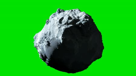 asteroid : Detailed rotating asteroid or meteor with green screen background