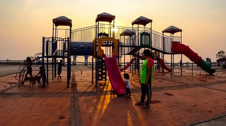 mais : Time lapse of children play at playground with sunset sky in Chonburi, Thailand