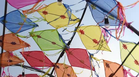 pipa : Thai vintage kite movement by wind at backdrop with blue sky background, Handheld shot Stock Footage