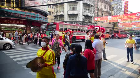 yaowarat road : BANGKOK, THAILAND - 4 FEB : Lion dancer walk along road and People walk across Yaowarat road on 4 February 2019 in China town, Bangkok, Thailand