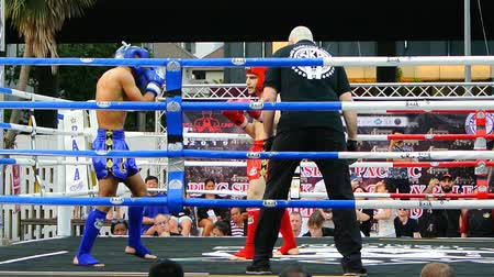 handheld shot : BANGKOK, THAILAND - 15 MAR : Unidentified kick boxing fighter fighting at boxing ring on 15 March 2019 in Bangkok, Thailand Stock Footage