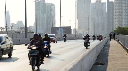 BANGKOK, THAILAND - 13 MAR : Car and motorcycle transport at Taksin bridge on 13 March 2019 in Bangkok, Thailand
