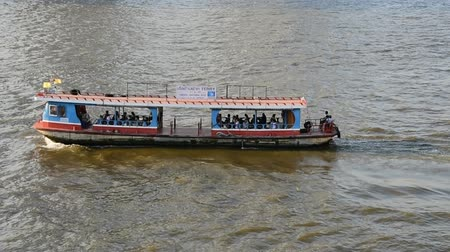 BANGKOK, THAILAND - 13 MAR : Ferry boat a cross Chao Phraya river on 13 March 2019 in Bangkok, Thailand