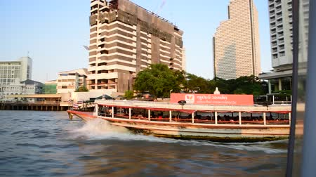 BANGKOK, THAILAND - 13 MAR : Passenger boat at Chao Phaya river view from boat on 13 March 2019 in Bangkok, Thailand