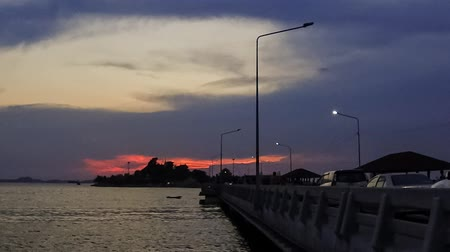 CHONBURI, THAILAND - 9 APR :Time lapse of twilight sky with bridge foreground on 9 April 2019 in Sriracha city, Chonburi, Thailand