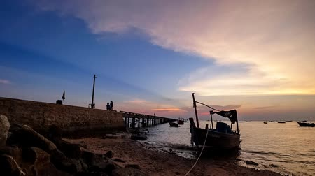 CHONBURI, THAILAND - 12 APR : Silhouette of fishing boat at sea with twilight sky on 12 April 2019 in Chonburi, Thailand