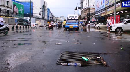 CHONBURI, THAILAND - 7 JUNE : Flood water splashing in rain drain at road on 7 June 2019 in Sriracha, Chonburi Thailand