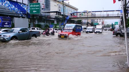 CHONBURI, THAILAND - 7 JUNE : Traffic with flood on 7 June 2019 in Sriracha, Chonburi, Thailand