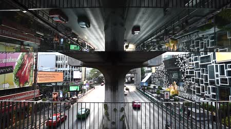 BANGKOK, THAILAND - 6 MAY : Traffic at Siam Discovery with reflection of road on ceiling of overpass on 6 May 2019 in Bangkok, Thailand