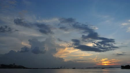 4K Time lapse of sunset sky at sea, Chonburi, Thailand