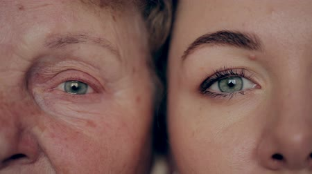 yaşlanma : concept of aging and skin care. face of young woman and an old woman with wrinkles.