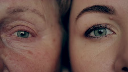 бабушка : Old and young eye. Granddaughter and grandmother face to face.