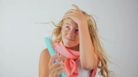 Hair care, hairstyle and people concept - young woman or teenage girl confused.