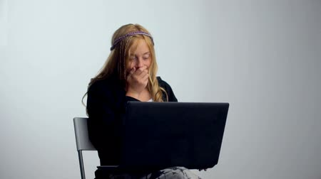 Young girl holds laptop. Shocked caucasian teenager with notebook at studio. Stock Footage