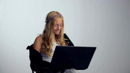 Happy girl with a laptop - isolated over a white background.