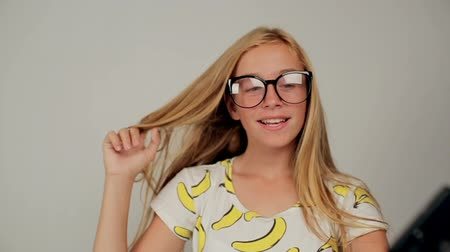 Beautiful smiling blonde girl wears glasses making selfie by smartphone. Stock Footage