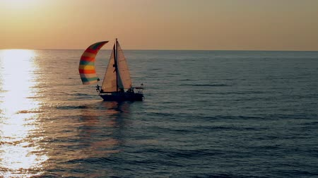 Sailboat in the sea in the evening sunlight, luxury summer adventure, active vacation.