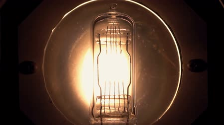 Light bulb flickering macro. Vintage filament light bulb. Close up.