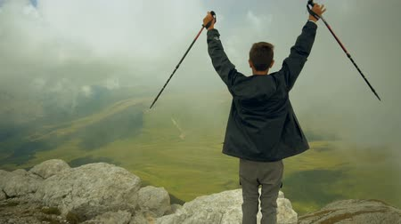 climbed : A carefree and free boy raised his hands and looked at the sky. Young backpacker climbed to the top. Stock Footage